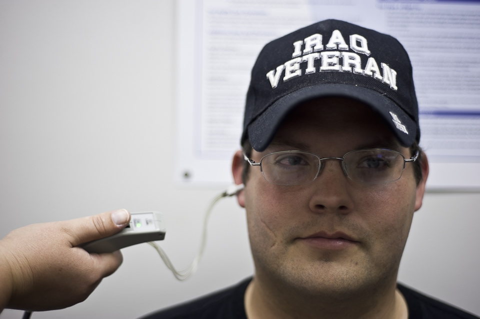 Jared gets his ears checked in Spokane for his VA benefits. Photo by: AJ Chavar