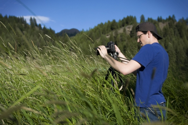 News21 fellow David Miller shoots test video in a meadow. Photo by Kelly West
